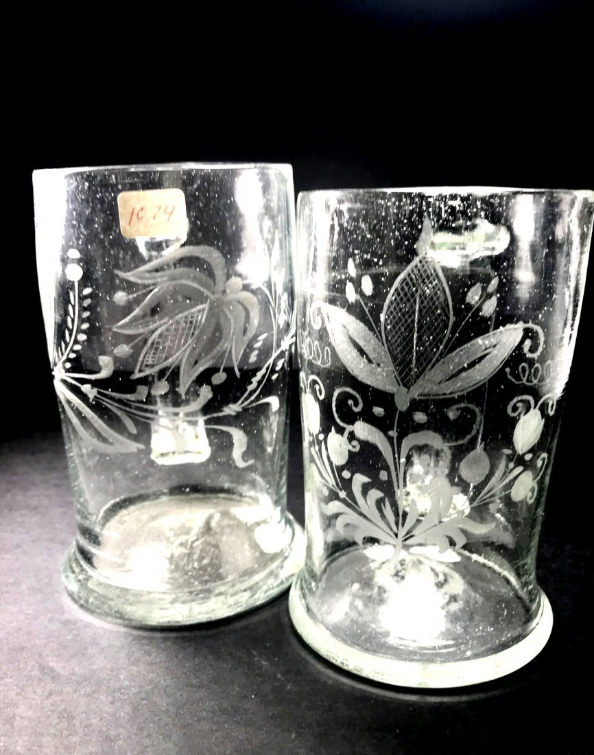 A PAIR OF ENGRAVED 18TH CENTURY FREE BLOWN MUGS