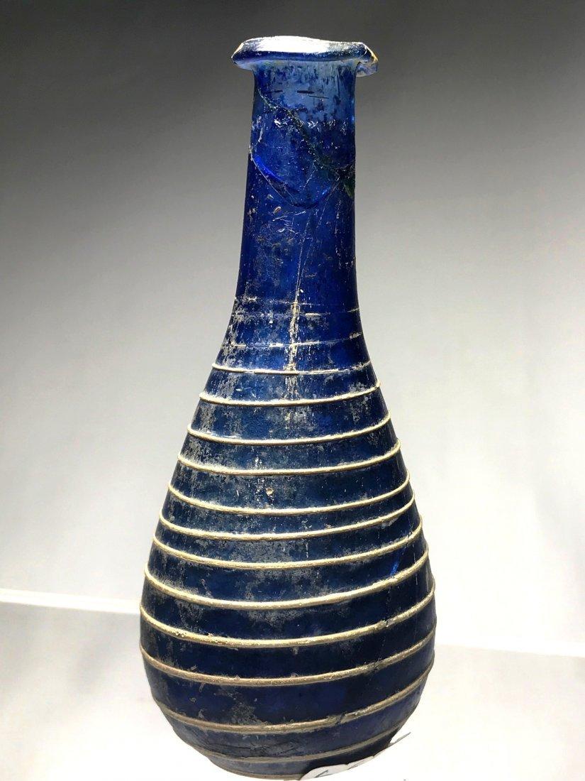 ROMAN BLUE UNGUENTARIUM DECORATED IN OPAQUE WHITE GLASS