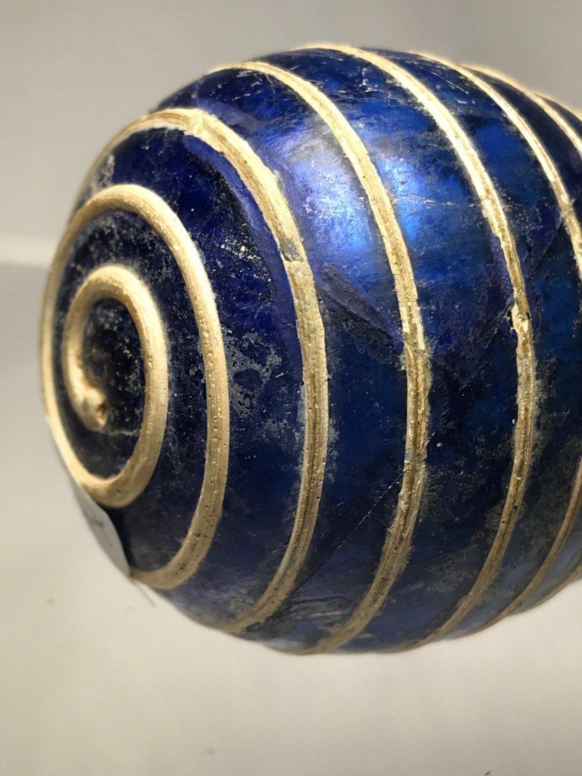 ROMAN BLUE UNGUENTARIUM DECORATED IN OPAQUE WHITE GLASS - 3