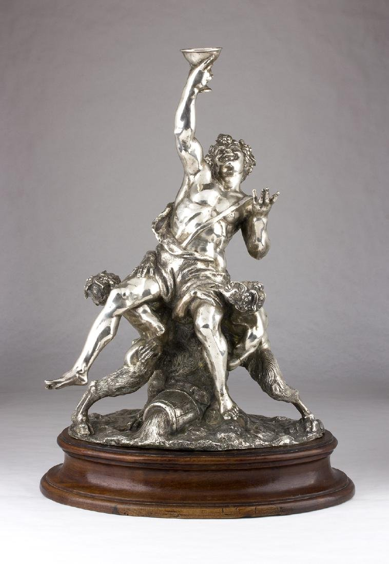 A SOLID 800‰ SILVER FIGURAL GROUP DEPICTING BACCHUS