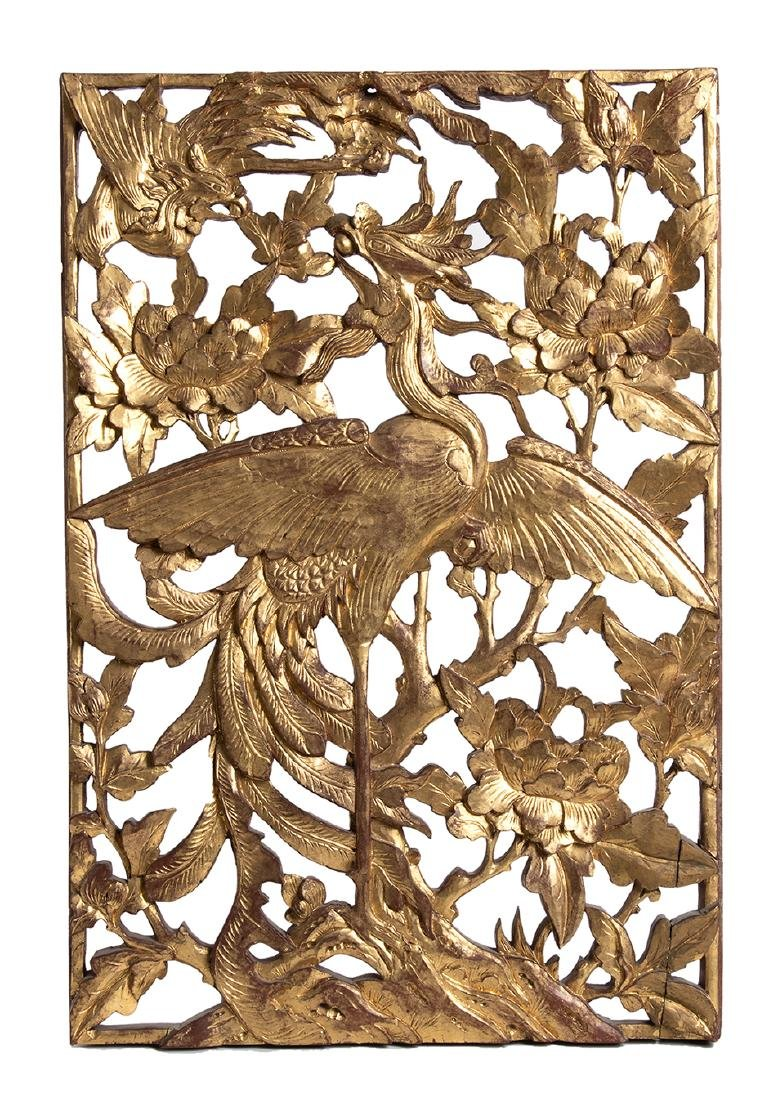 A CARVED AND GILT WOOD 'PHOENIX AND PEONIES' OPENWORK