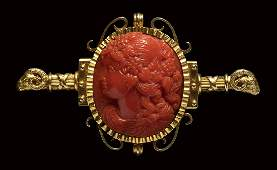 A  fine Victorian coral cameo set in a gold brooch.