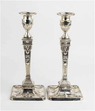 Pair of English sterling silver Victorian candlesticks