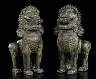 A PAIR OF BRONZE KHMER STYLE BUDDHIST LIONS Cambodia,
