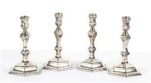 Set of four Britannia silver standard candlesticks -