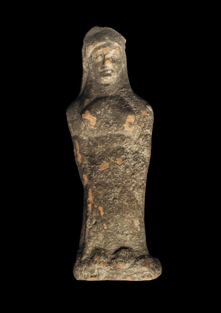 Terracotta statuette of a kore in Daedalic style Greek,