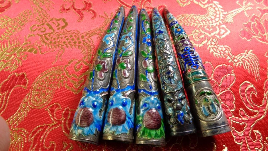 Set of 5 Chinese enamel fingernail guards.