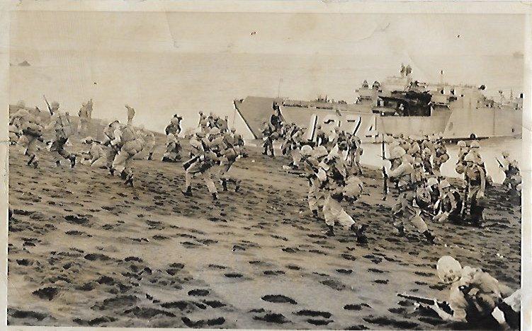 1956  Photo Marines come ashore at Iwo Jima in reenactm