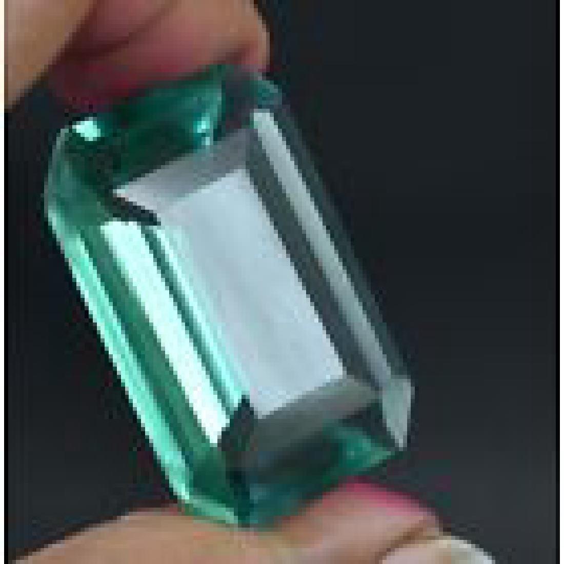 GGL Certified 61.75 Ct Emerald cut Light green Topaz