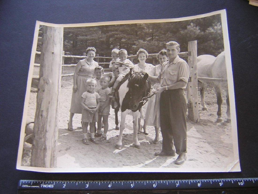 B&W Boys sit on same pony horse, 7 other family m.Photo