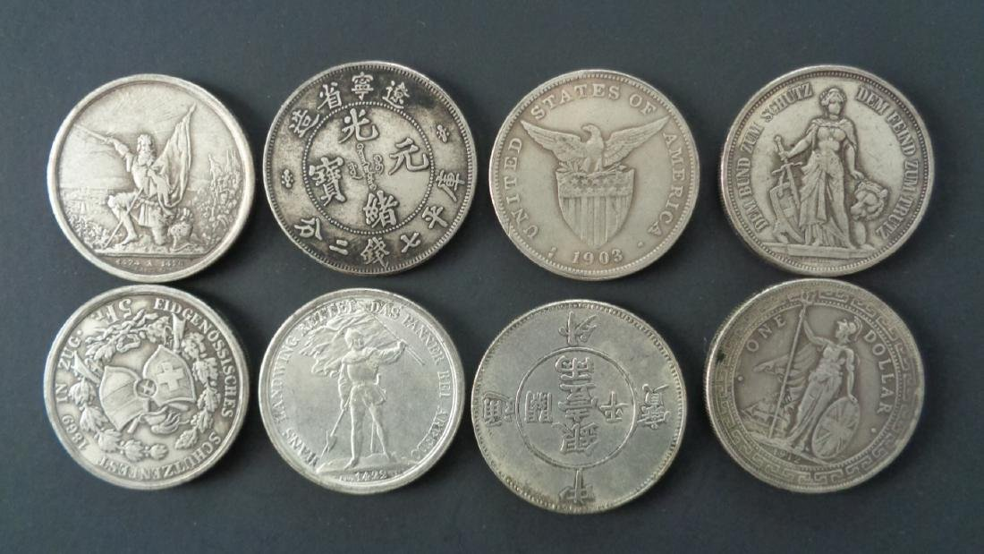 Lot of 8 Chinese Coins.