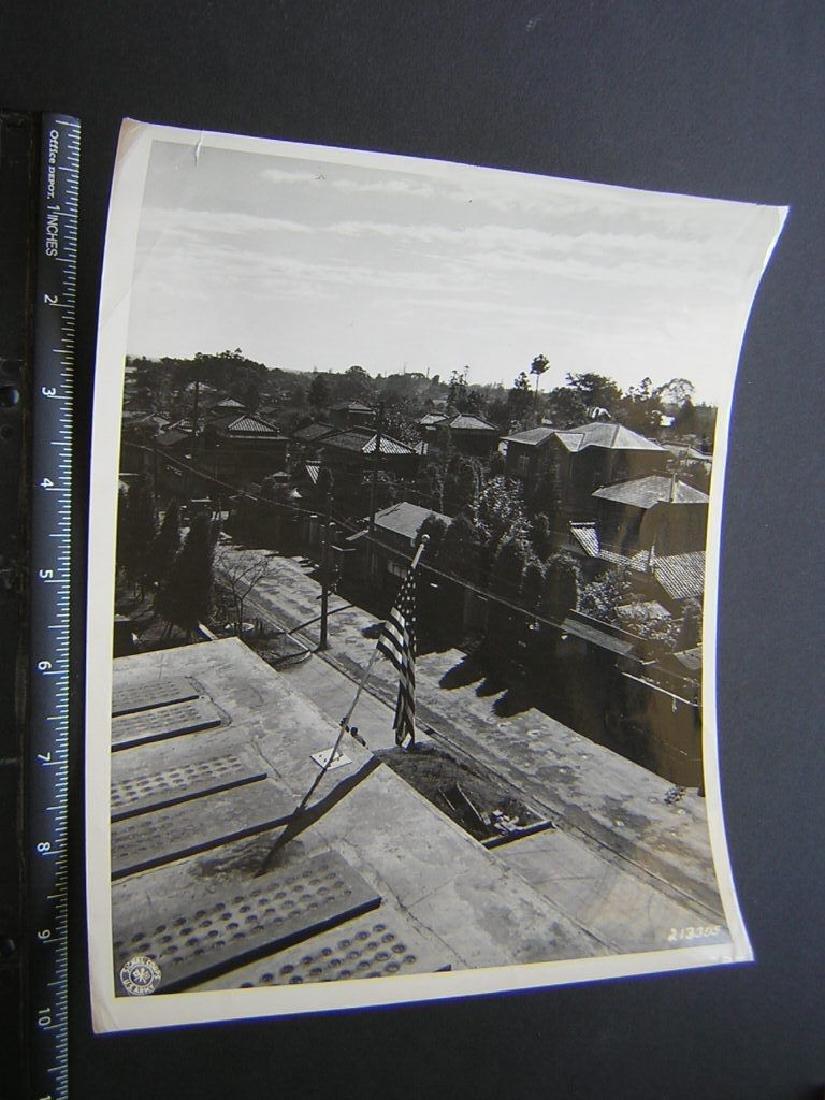 B&W VTG  WW2 Japan homes w US flag shot from  .Photo