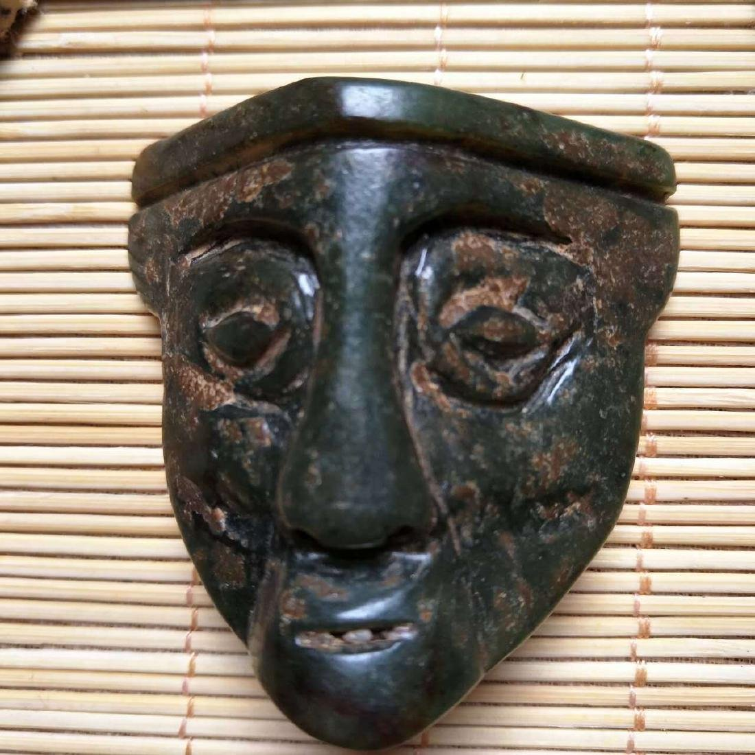 Antique Carved Jade Mask. Long: 46mm x Wide:50mm x Thic