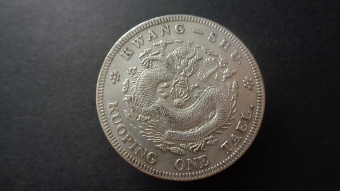"Old chinese silver coins ""DQ YB JI 吉"""