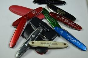 12 advertising pocket knives, whereof 1 Patek Philippe