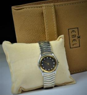 Lady's wristwatch EBEL with diamonds. Diameter 24 mm.