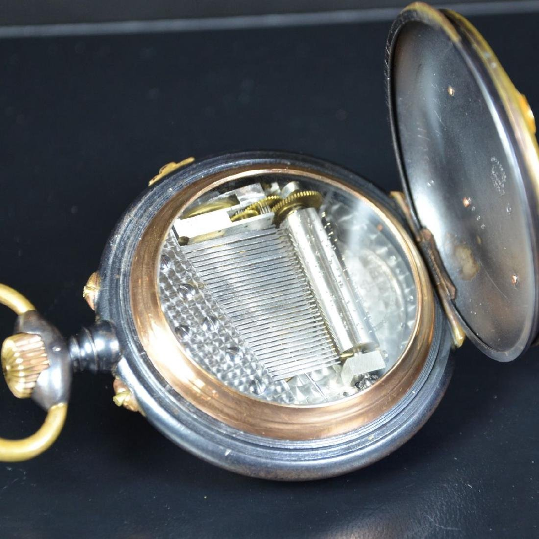 Brown steel Pocket watch and medallion in 18ct gold.