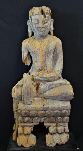 Sitting teakwood Shan Buddha, strong weathering traces.