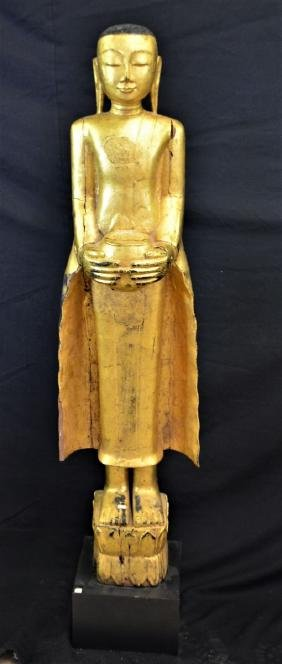 Teakwood Buddha, hand carved, partially gilded, on a