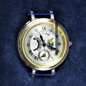 Wristwatch in gold and steel with power reserve and