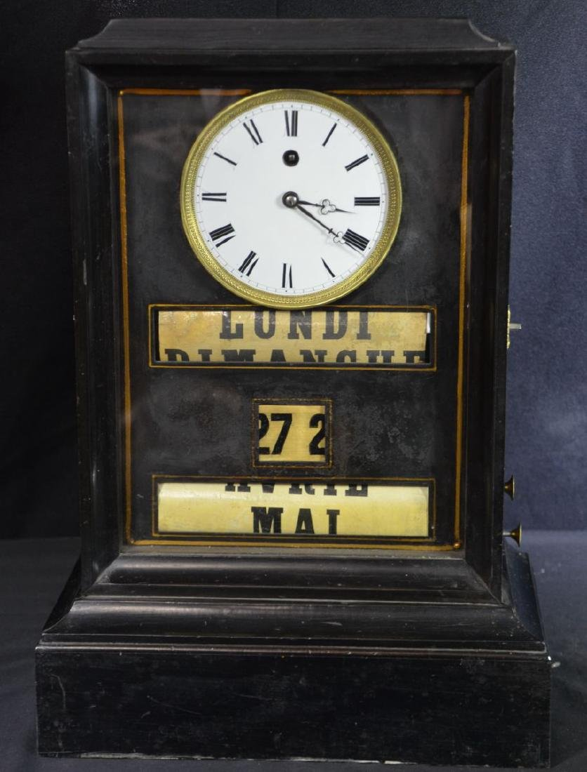 Table pendulum. Black with enameled clock face. Rolling
