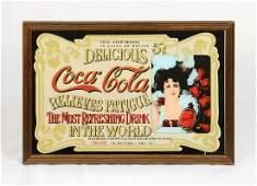 """Advertisement on mirror """"Delicious Coca-Cola"""""""