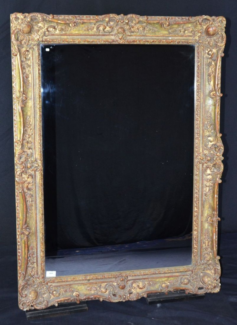 Eye catching Mirror in a richly ornamented and gilded