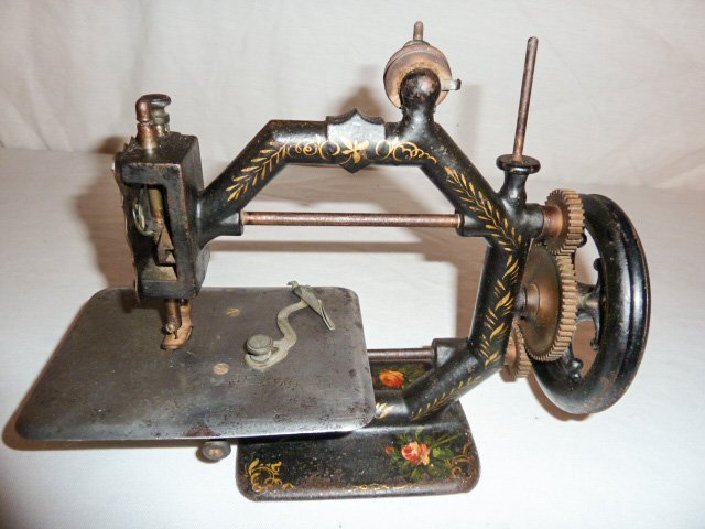 EARLY PAINT DECORATED MINIATURE SEWING MACHINE