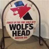 vintage freestanding metal Wolfs Head Motor Oil sign