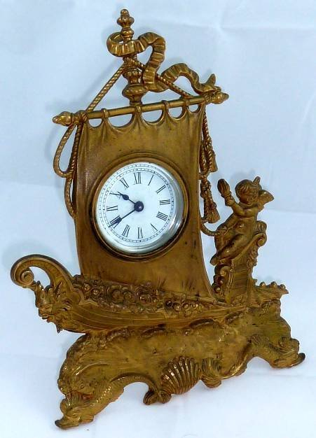 BRONZE  CLOCK WITH FIGURAL ANGEL SAILING SHIP