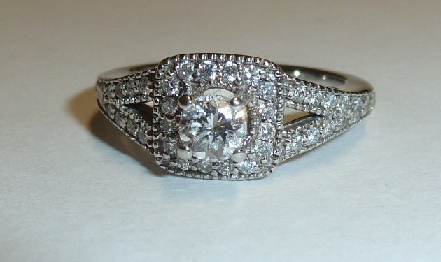 14KT DIAMOND RING 1/4 CT RAISED CENTER STONE