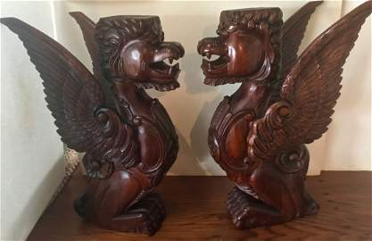 A Pair of Carved Wood Architectural Winged Griffins