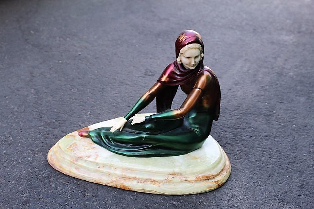 Art Deco Figurine of a Seated Girl Titled Genevie