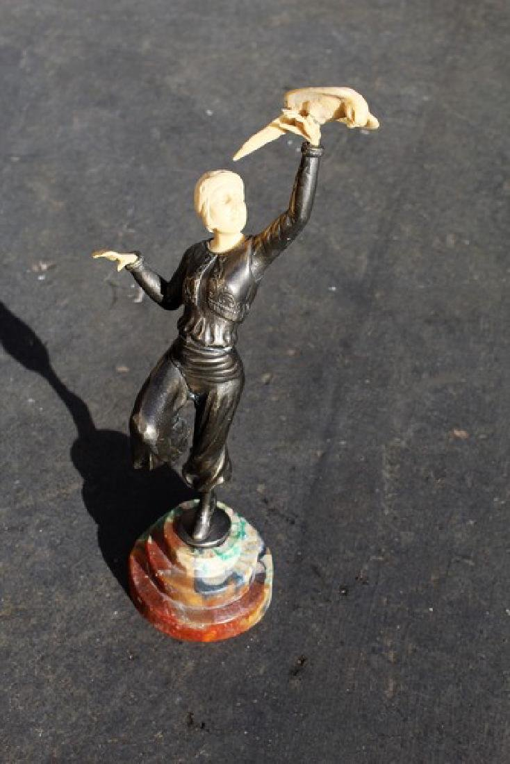 Art Deco Figurine of a Girl Holding a Parrot