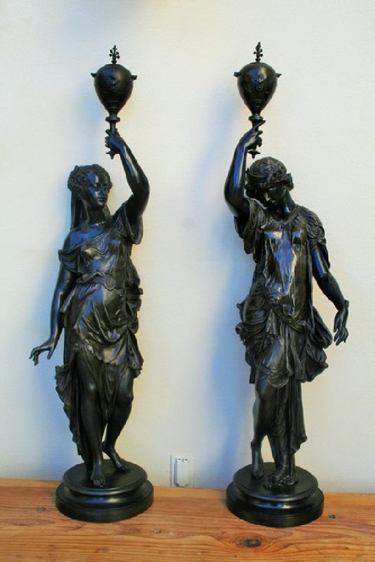 Pair of Antique Newl Post Figurines