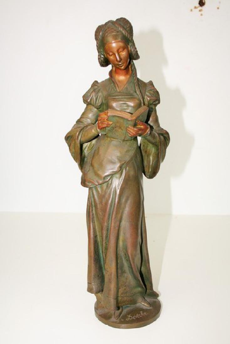 Antique Figurine of a Lady Reading a Book