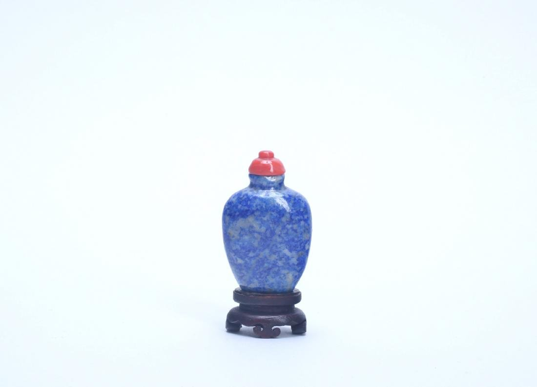 A Chinese Snuff Bottle with Wood Base