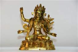 A Chinese Bronze Gilding Buddha Statue.