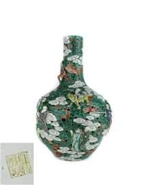 A Chinese Famille-Rose Carved Porcelain Vase