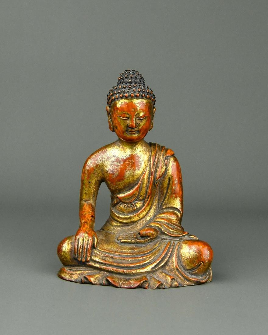 A Chinese Carved Gilt Wood Buddha