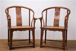 A Pair of Chinese Carved Huanghuali Chairs