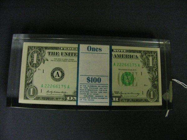 1503: 100 1969 U.S. ONE DOLLAR BILLS ENCASED