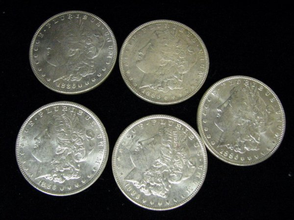 3807: 5 1886 U.S. MORGAN SILVER DOLLARS