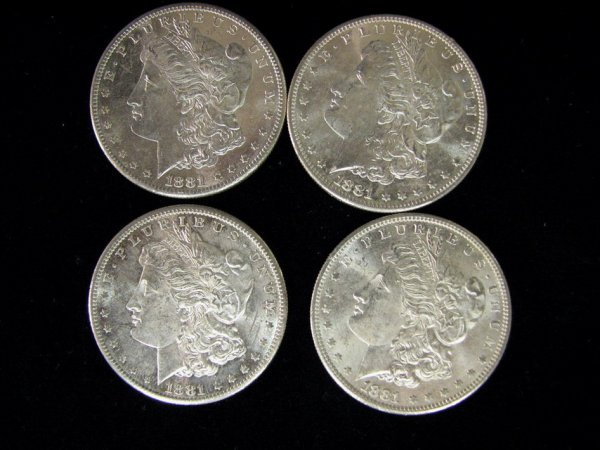 3811: 4 1881 U.S. MORGAN SILVER DOLLARS