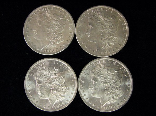3812: 4 1883 U.S. MORGAN SILVER DOLLARS