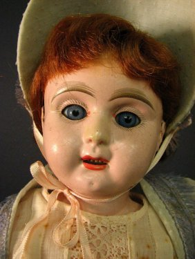 TIN HEAD DOLL