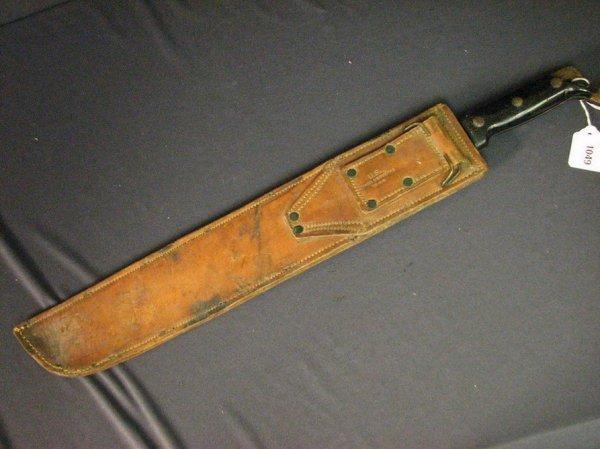 1049: U.S. WWII TRUE TEMPER MACHETE WITH SCABBARD