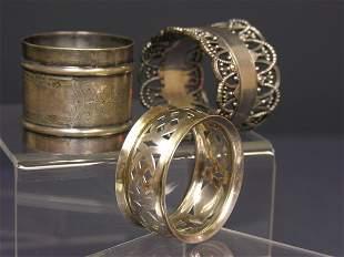 THREE EARLY NAPKIN RINGS