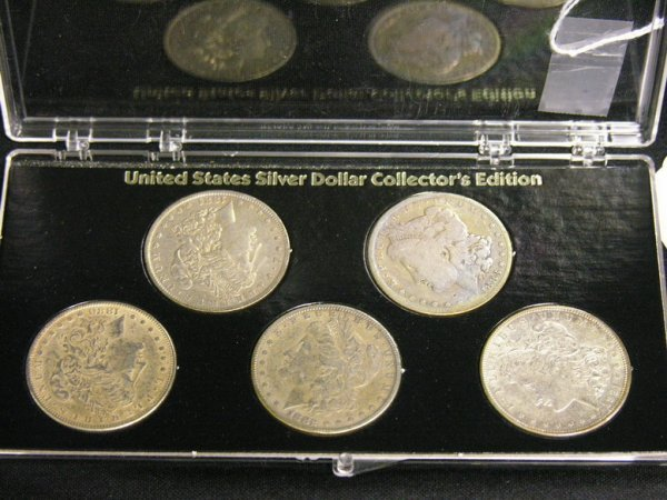 1015: FIVE U.S. SILVER MORGAN DOLLARS ESTATE LOT