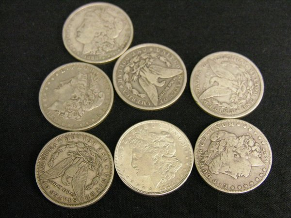 1016: SEVEN U.S. SILVER MORGAN DOLLARS ESTATE LOT